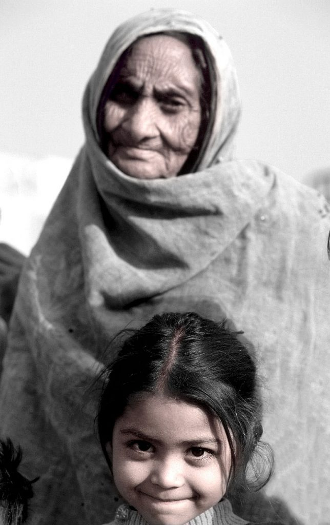 Hope-for-the-future-older-poor-woman-granddaughter-Delhi-India-Ron Levy Photography