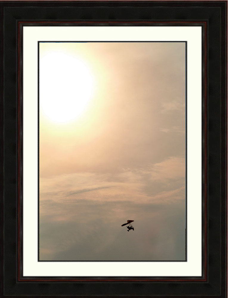 Ultralight-aircraft-clouds-sunset-Mexico-Ron Levy Photography