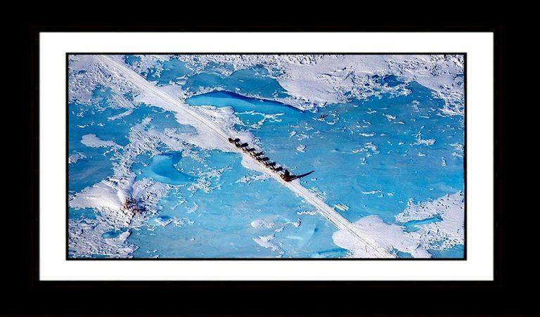 teamwork-Iditarod-dogteam-crossing-frozen-lake-Alaska-Ron Levy Photography