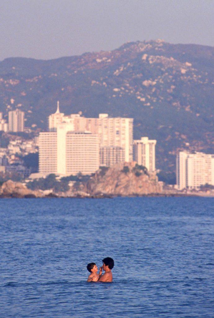 Father-son-together-beach-ocean-Acapulco-Mexico--Ron Levy Photography